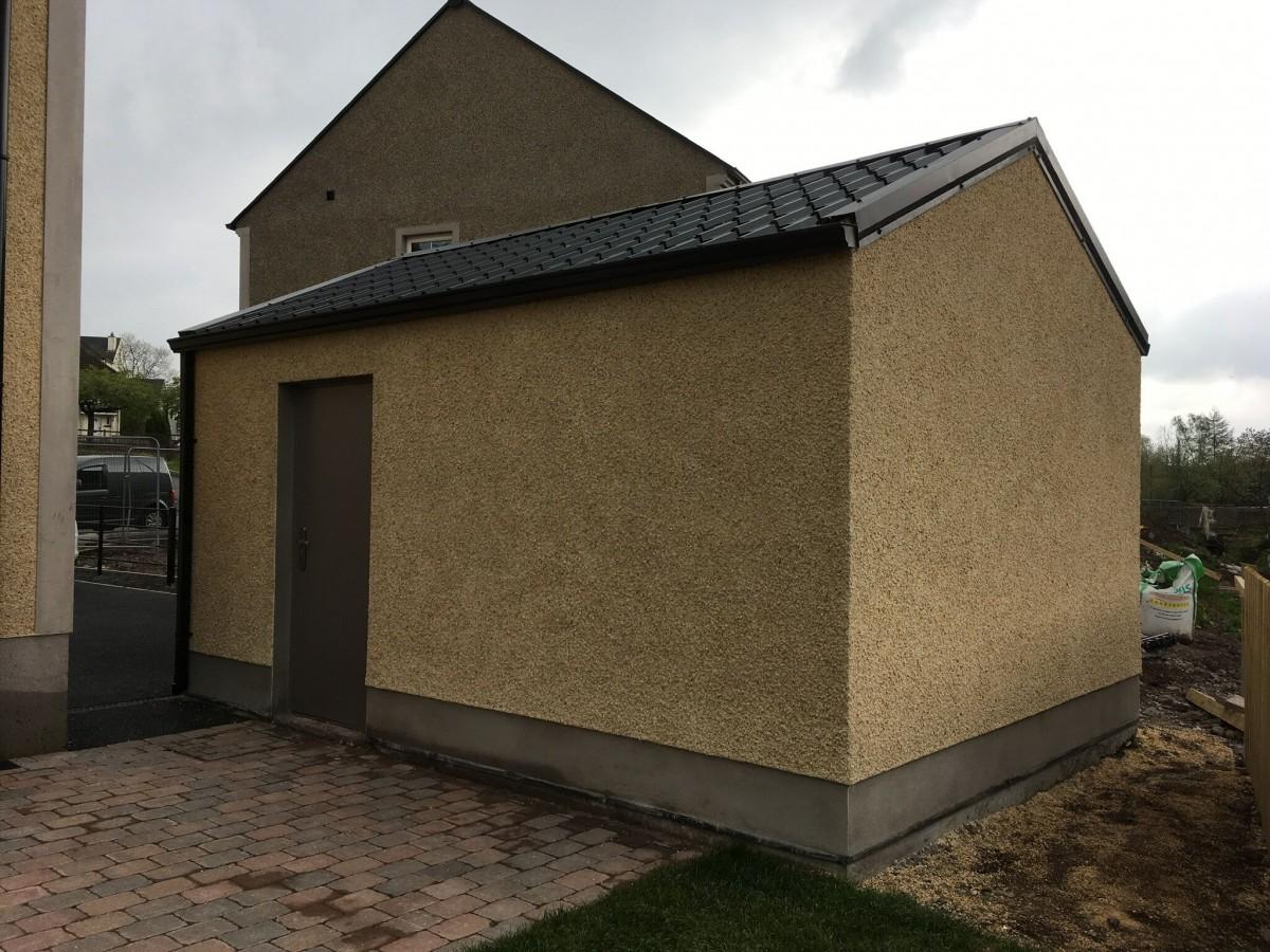 tile effect cladding on rendered building